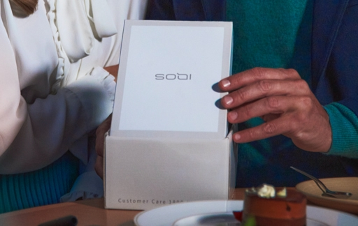 A person holding an IQOS box.